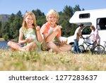 children in countryside on... | Shutterstock . vector #1277283637