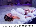 young woman in red bikini...   Shutterstock . vector #1277312227