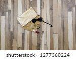 the golden bag fell to the... | Shutterstock . vector #1277360224