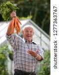smiling senior man holding... | Shutterstock . vector #1277363767