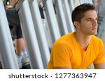 active young man by treadmills... | Shutterstock . vector #1277363947