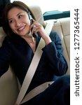 businesswoman in backseat of... | Shutterstock . vector #1277365444