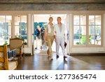 couple arriving in hotel foyer... | Shutterstock . vector #1277365474