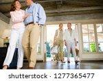 couples arriving in hotel foyer ... | Shutterstock . vector #1277365477