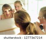 teenage girl friends doing eye... | Shutterstock . vector #1277367214