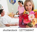 woman visiting male patient... | Shutterstock . vector #1277368447