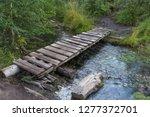 old small bridge through a... | Shutterstock . vector #1277372701