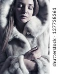 beautiful lady in a fur   Shutterstock . vector #127738361