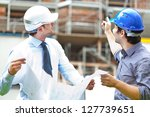 two engineers working in a... | Shutterstock . vector #127739651