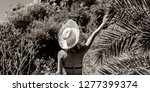 young girl in bikini and hat... | Shutterstock . vector #1277399374
