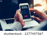 hands using mobile banking on... | Shutterstock . vector #1277457367