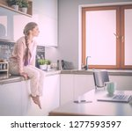 young woman sitting on table in ... | Shutterstock . vector #1277593597