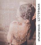 young beautyful woman under... | Shutterstock . vector #1277594644