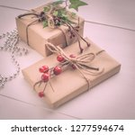 christmas gift boxes and fir... | Shutterstock . vector #1277594674