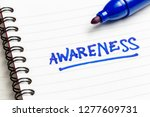Small photo of Awareness topic, handwriting note on notebook
