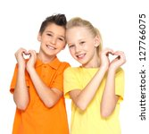 Photo of happy children with a sign of heart shape  isolated on white background - stock photo