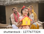 little indian girl holding... | Shutterstock . vector #1277677324