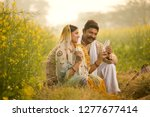 rural couple holding indian... | Shutterstock . vector #1277677414