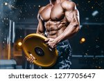 brutal strong bodybuilder... | Shutterstock . vector #1277705647