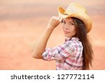 Young American Cowgirl Woman...