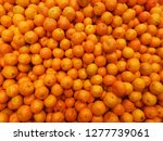 ripe tangerines on a shop... | Shutterstock . vector #1277739061