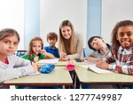 pupils in a class of a primary... | Shutterstock . vector #1277749987
