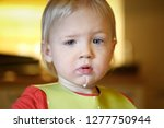 toddler with milk moustache... | Shutterstock . vector #1277750944