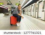 attractive girl traveler... | Shutterstock . vector #1277761321