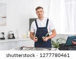 smiling adult repairman taking... | Shutterstock . vector #1277780461