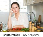 young tired female housewife... | Shutterstock . vector #1277787091
