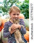 cute little girl with kitten. | Shutterstock . vector #1277793277