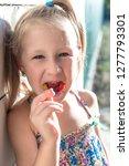 little girl shows his... | Shutterstock . vector #1277793301