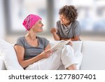 mother reading with her son on... | Shutterstock . vector #1277807401