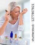 herbal medicine   old woman... | Shutterstock . vector #1277807821