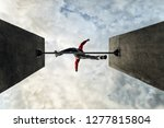 man jumps over obstacle.... | Shutterstock . vector #1277815804