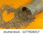 jute sack and fresh raw wheat... | Shutterstock . vector #1277828317