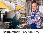 cheerful smiling workman in... | Shutterstock . vector #1277860297