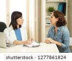 female family doctor listening... | Shutterstock . vector #1277861824