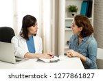 female family doctor listening... | Shutterstock . vector #1277861827