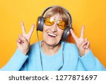 funny old lady listening music... | Shutterstock . vector #1277871697