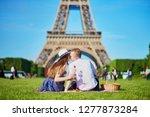 romantic couple having picnic... | Shutterstock . vector #1277873284
