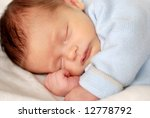 a beautiful baby taking a nap   Shutterstock . vector #12778792
