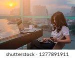 happy asian woman working using ... | Shutterstock . vector #1277891911