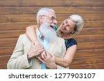 happy fashion seniors couple... | Shutterstock . vector #1277903107