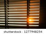 opened venetian plastic blinds... | Shutterstock . vector #1277948254