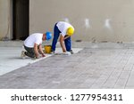bricklayer at work in building... | Shutterstock . vector #1277954311