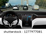 self driving car on a road.... | Shutterstock . vector #1277977081