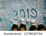 feet in snow boots in 2019 in... | Shutterstock . vector #1278034744
