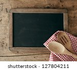 Blackboard On Wooden Surface...