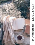 opened book  cup of tea or... | Shutterstock . vector #1278057184